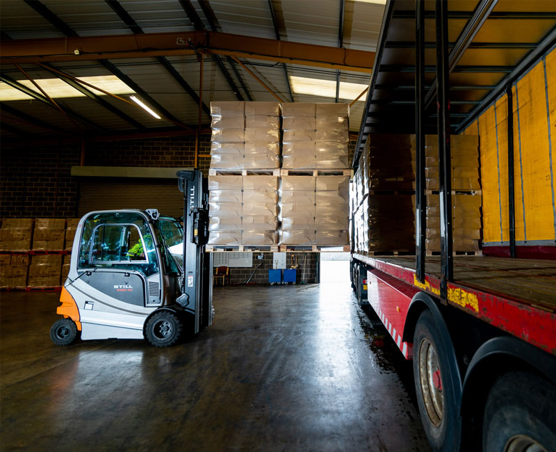 fork list truck loading at transport lorry